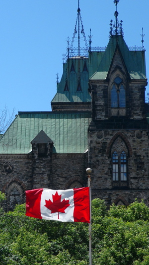 Canadian Flag with the Parliament Buildings