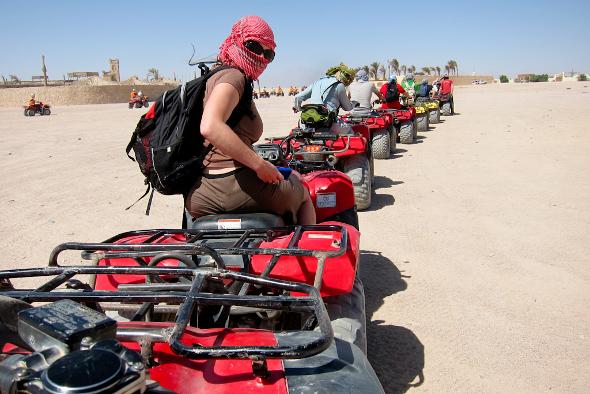 Emme Rogers and Audrey Scott quad biking through the desert outside of Hurghada, Egypt.